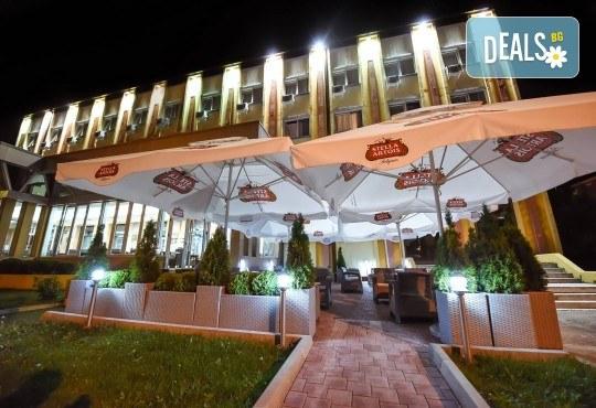 Нова година в Пожега, Сърбия! 2 нощувки със закуски в хотел 3*, 1 вечеря, Новогодишна вечеря с неограничени напитки и програма, транспорт - Снимка 2