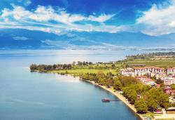 Почивка край брега на Охридското езеро през лятото! 5 нощувки със закуски и вечери във вила Ловец, транспорт и посещение на Скопие - Снимка