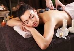 100-минутен СПА пакет Афродизиак с пилинг масаж на цяло тяло с шоколадови соли, кралски масаж с топло масло от сандалово дърво и амбър и вулканични камъни на гръб в Wellness Center Ganesha Club - Снимка