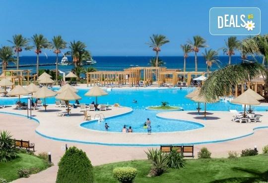 Супер промо за почивка в Египет през март! 7 нощувки All Inclusive в Grand Seas Resort Hostmark 4*, Хургада, самолетен билет с директен чартърен полет и трансфери - Снимка 1