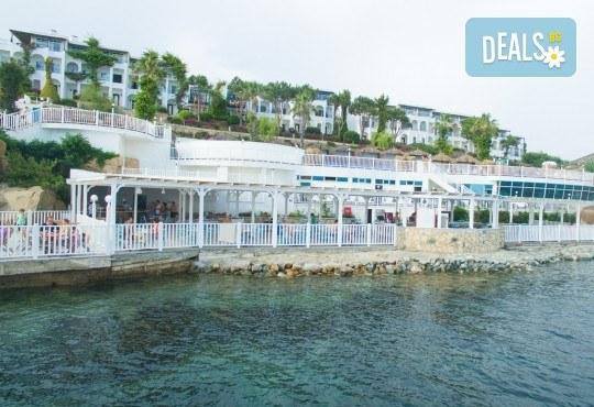 Почивка в края на лятото в Kadikale Resort 5* в Бодрум! 7 нощувки на база All Inclusive, възможност за транспорт - Снимка 1