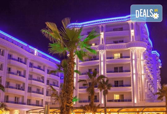 Посрещнете Нова година 2021 на брега на Адриатика в хотел Fafa Premium Resort 4*, Албания, с АБВ Травелс! 3 нощувки със закуски и 2 вечери, транспорт, посещение на Скопие и Охрид - Снимка 1