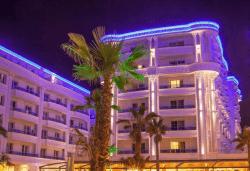 Посрещнете Нова година 2021 на брега на Адриатика в хотел Fafa Premium Resort 4*, Албания, с АБВ Травелс! 3 нощувки със закуски и 2 вечери, транспорт, посещение на Скопие и Охрид - Снимка