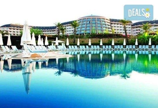 Посрещнете Нова година в Long beach resort & SPA 5*, Анталия! 5 нощувки на база All Inclusive и възможност за транспорт - Снимка 1