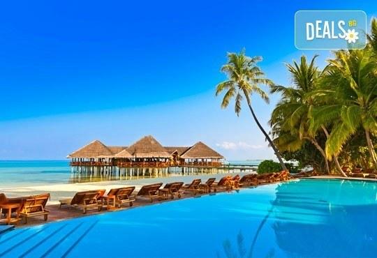 Посрещнете Нова година на Малдивите! 9 нощувки на база пълен пансион и празнична вечеря в Ranveli Village 4*, самолетен билет! - Снимка 1