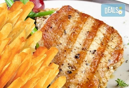 Класическо предложение за порция вратна пържола, гарнирана със зелева салата и пържени картофи в Bar & Dinner seven7A! - Снимка 1