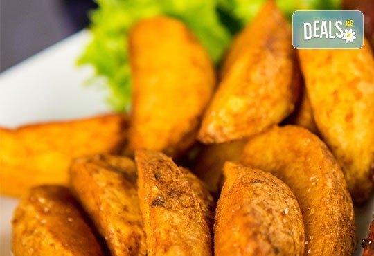 Предплатете 1.20 лв. за овчарска салата и свинска или пилешка пържола по избор с картофки Уеджис в ресторант Санури! - Снимка 2