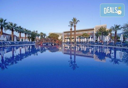 Почивка в Кушадасъ! 4 или 5 нощувки на база Аll Inclusive в Palm Wings Beach Resort Kusadasi 5* с Ориент 99! - Снимка 1