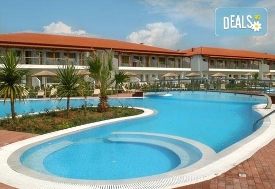 Почивайте през май в Alexandros Palace Hotel & Suites 5*, Халкидики! 3 или 5 нощувки със закуски и вечери, безплатно за дете до 12г.! - Снимка 1