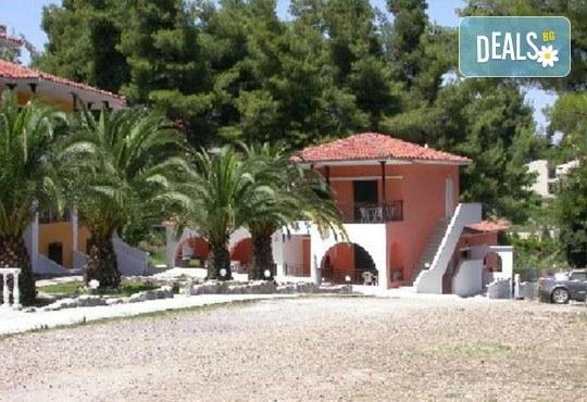 Почивка през юни или юли в Халкидики, Гърция! 7 нощувки със закуски и вечери в Kassandra Bay Village 3* в Kриопиги! - Снимка 6