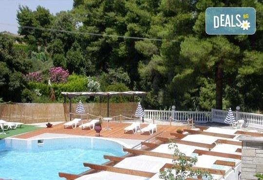 Почивка през юни или юли в Халкидики, Гърция! 7 нощувки със закуски и вечери в Kassandra Bay Village 3* в Kриопиги! - Снимка 5