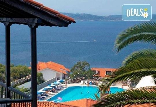 Гореща лятна почивка в Aristoteles Holiday Resort & Spa 4*, Халкидики - 3/4/5 нощувки със закуски и вечери, безплатно за дете до 11.99г. - Снимка 1