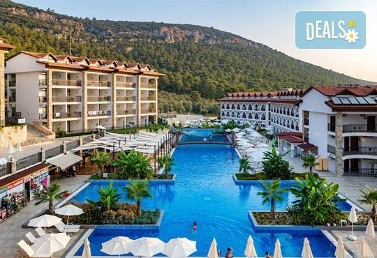 Супер почивка - на море през юли в Ramada Resort Hotel Akbuk 4+*, Дидим! 7 нощувки, All Inclusive и възможност за транспорт! Дете до 11 години безплатно! - Снимка 1