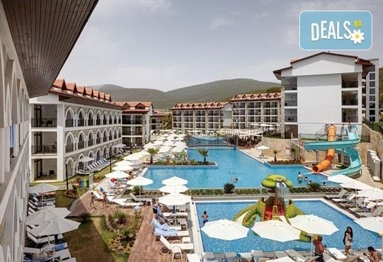 През септември и октомври почивка в Дидим, Турция! 7 нощувки на база All Inclusive в Ramada Resort Akbuk 4* и възможност за транспорт! Дете до 12 години безплатно! - Снимка 1