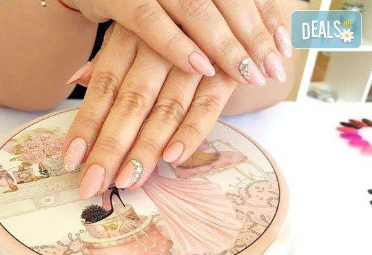 Подарете на ръцете си красота и цвят с класически маникюр с CND Creative play или S.N.B., 2 декорации по избор в салон RalNails! - Снимка 2