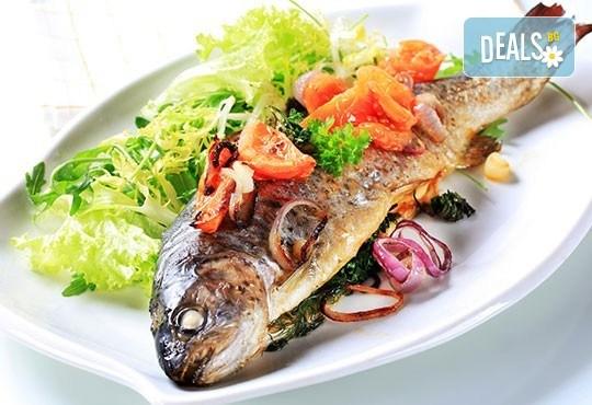 Апетитно предложение от Ресторант механа Караджата! 2 порции пъстърва на скара или на тиган с гарнитура сотирани картофи - Снимка 1