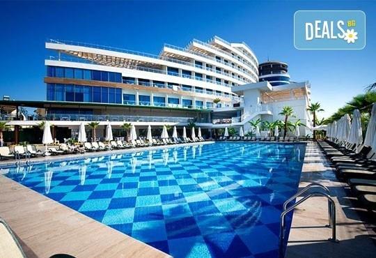 Почивка в Анталия, самолетна програма, септември - 7 нощувки на база Ultra All Inclusive в Raymar Hotel 5*, билет, летищни такси и трансфери! - Снимка 1
