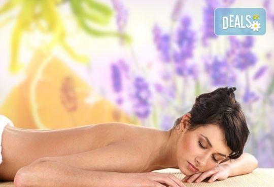 Болкоуспокояващ масаж на гръб, врат, рамене и кръст с масло от алое, лавандула, иланг-иланг и портокал в Wave Studio - НДК - Снимка 1