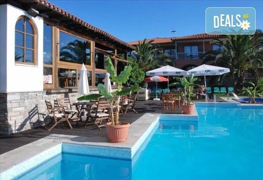 Почивка в Гърция през септември или октомври! 3 нощувки със закуски в Hanioti Village & Spa Resort 2*+, Касандра, Халкидики! - Снимка 2