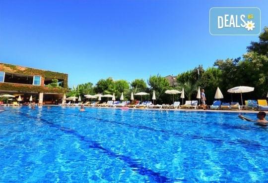 Last minute почивка през октомври в Анталия! 7 нощувки на база All Inclusive в Primasol Telatiye Resort Hotel 5*, двупосочен билет, летищни такси и трансфери - Снимка 1