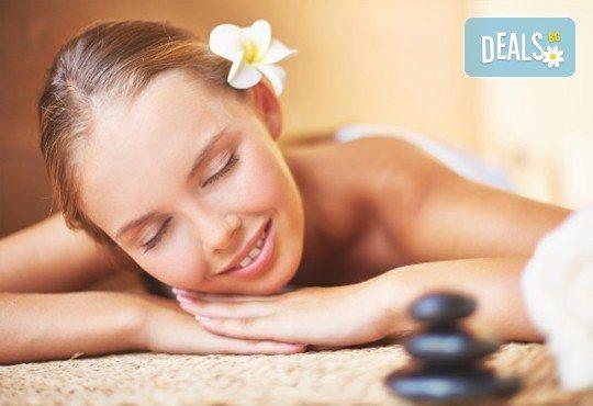 Релаксиращ масаж на гръб с топли вулканични камъни, Hot Stone терапия и етерични масла бадем или лайка в Спа център Senses Massage & Recreation! - Снимка 1