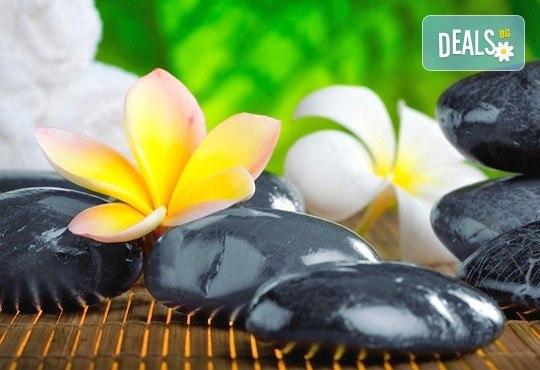 Отпуснете мускулите и стоплете тялото си в студените дни с релаксиращ масаж на гръб с вулканични камъни в Gx Studio! - Снимка 2