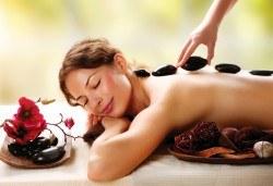 Релаксиращ масаж на гръб с топли вулканични камъни, Hot Stone терапия и етерични масла бадем или лайка в Спа център Senses Massage & Recreation! - Снимка