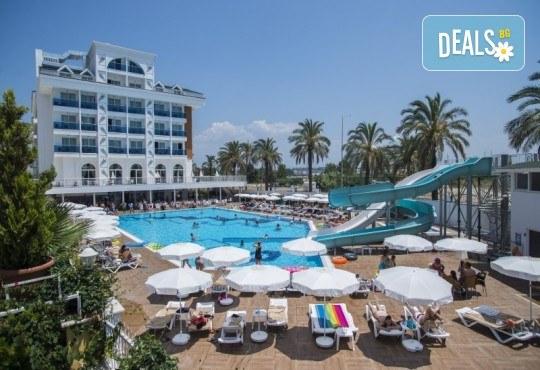 Почивка в Анталия през април или май! 7 нощувки на база All Incl в Palm World Side Resort & SPA 5*, билет, летищни такси и трансфери! - Снимка 1