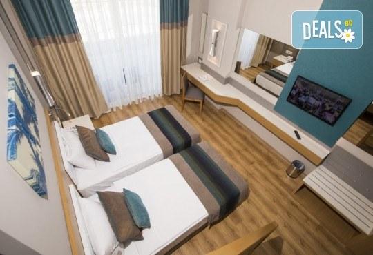 Почивка в Анталия през април или май! 7 нощувки на база All Incl в Palm World Side Resort & SPA 5*, билет, летищни такси и трансфери! - Снимка 4