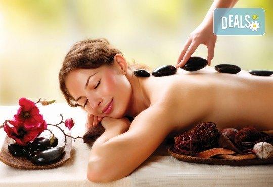 Релаксиращ масаж на гръб с топли вулканични камъни, Hot Stone терапия и етерични масла бадем или лайка в Спа център Senses Massage & Recreation! - Снимка 2