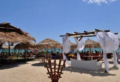 На плаж в слънчева Гърция за ден в Паралия Офринио! Транспорт, застраховка и водач от Глобус Турс! - Снимка
