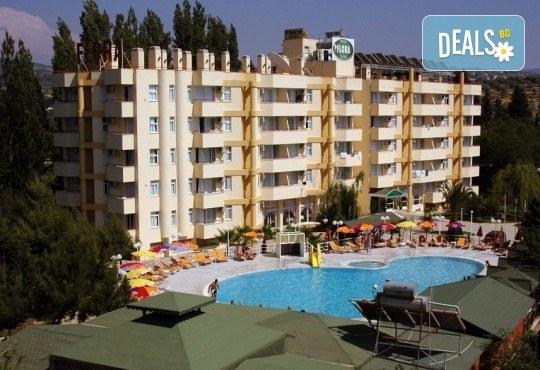 Лятна почивка в Кушадасъ, Турция! 7 нощувки на база All Inclusive във Flora Suites 3*, безплатно за дете до 12.99 г. - Снимка 1