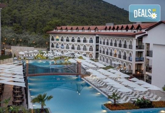 Септемврийска почивка в Дидим, Турция: 5 нощувки на база All Inclusive в Ramada Resort Hotel Didim 4* от Глобул Турс! Безплатно за дете до 11 години! - Снимка 1