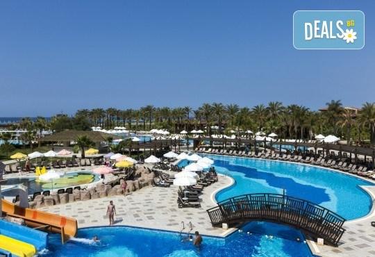С деца на море през септември в Сиде, Анталия! 7 нощувки Ultra All Inclusive в хотел Club Calimera Serra Palace 5* и възможност за 2 вида транспорт! - Снимка 2