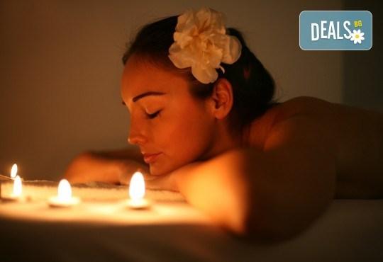 Масаж на гръб и ръце или гръб и стъпала с топла ароматна свещ в масажно студио Боди баланс - Снимка 1