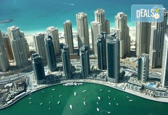 Екскурзия до Дубай през април с Караджъ Турс! 7 нощувки със закуски в Panorama Grand 3*, билет, летищни такси, чекиран багаж, водач, обиколка на Дубай и Шаржа - Снимка 1