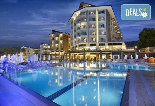 Майски празници в Кушадасъ, Турция! 5 нощувки на база All Inclusive в хотел Ramada Resort Kusadasi & Golf 5*, възможност за транспорт! - Снимка 1