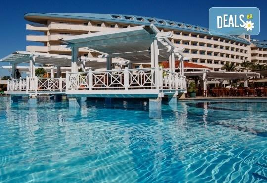 Почивка на Турската ривиера за Майските празници! 7 нощувки на база Ultra All Inclusive в Crystal Admiral Resort Suites & Spa 5*, Сиде, и 2 нощувки със закуски в Истанбул и Бурса, транспорт - Снимка 1