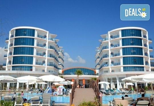 Почивка в Notion Kesre Beach Hotel 4+*, Кушадасъ, Турция, с Глобус Холидейс! 5 или 7 нощувки на база All Inclusive, възможност за транспорт - Снимка 1