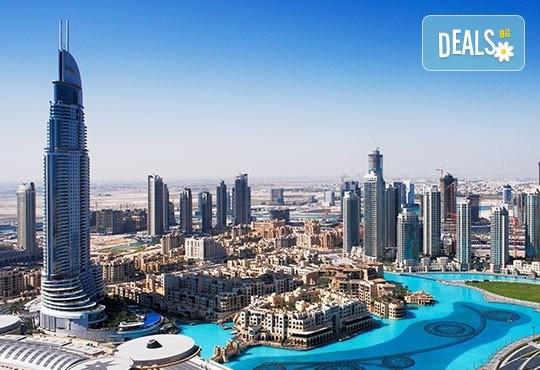 Екскурзия до Дубай през септември! 4 нощувки със закуски, самолетен билет, летищни такси, трансфери, обзорни обиколки, екскурзия до Абу Даби и сафари в пустинята! - Снимка 1