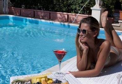 Почивка в Италия, Римини - 7 нощувки със закуски и вечери в Hotel Sunset 4*, самолетен билет, трансфери и екскурзии до Болоня, Сан Марино и в Римини - Снимка