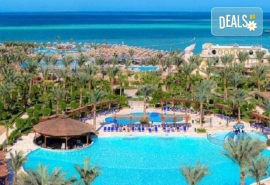 Почивка в Египет през есента! 7 нощувки на база All Inclusive в хотел Hawaii Le Jardain Aqua Park 5* в Хургада, самолетен билет, летищни такси и трансфери - Снимка 1