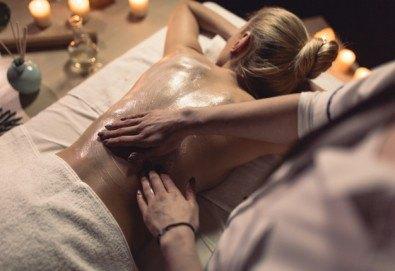 30-минутен лечебен масаж на гръб с луга от рехабилитатор + 15-минутна апликация на зона по избор и бонус: 20% отстъпка от всички продукти на Поморийска Луга в козметичен център DR.LAURANNE! - Снимка