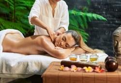 Лечебен масаж на гръб със загряващо олио Билков микс с наблягане на проблемна зона в студио Giro! - Снимка