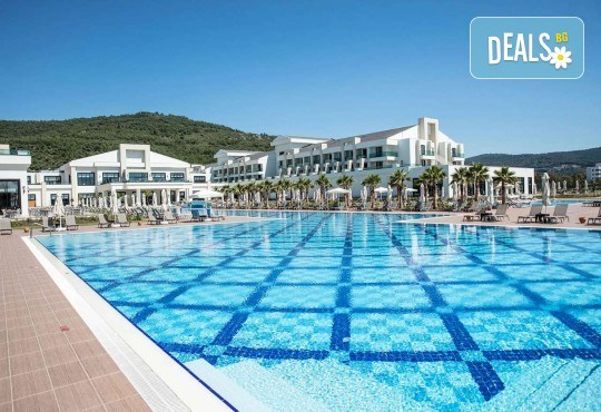 Почивка в Korumar Ephesus Beach & Spa Resort 5*, Кушадасъ, с Тансу Травел! 5/7 нощувки на база Ultra All Inclusive, възможност за транспорт - Снимка 1