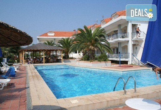 Почивка през септември в Hotel Rihios 3* в Ставрос, Гърция! 7 нощувки със закуски и вечери, възможност за организиран транспорт! - Снимка 1