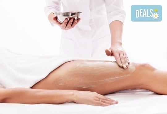 Готови за лятото! Антицелулитна терапия на зонa по избор, включваща пилинг, антицелулитен масаж с олио и крем Парафанго в студио Нимфея! - Снимка 1