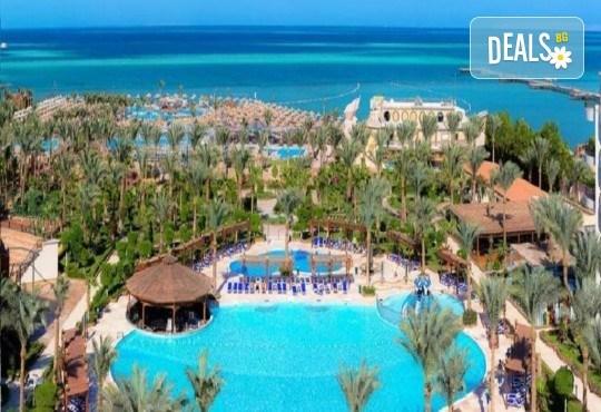 Почивка в Египет през есента! 7 нощувки на база All Inclusive в хотел Hawaii Le Jardain Aqua Park 5* в Хургада, самолетен билет с директен чартърен полет и трансфери - Снимка 1
