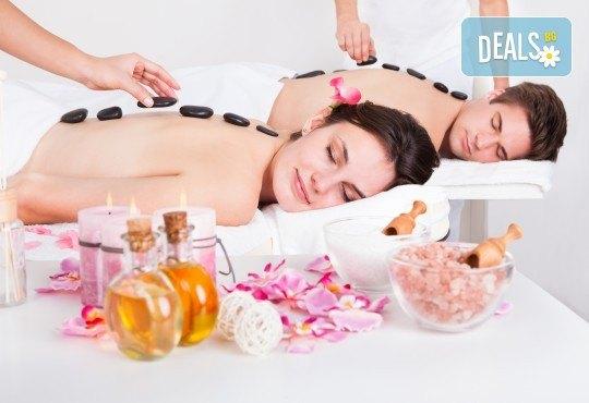 Вулканично сияние за двама! Дълбокорелаксиращ масаж за двама на цяло тяло със суфле от вулканични камъни в СПА център Senses Massage & Recreation - Снимка 1