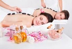 Вулканично сияние за двама! Дълбокорелаксиращ масаж за двама на цяло тяло със суфле от вулканични камъни в СПА център Senses Massage & Recreation - Снимка